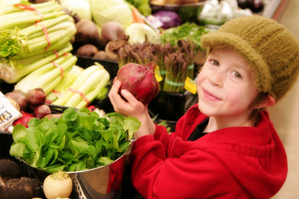boy-with-vegetables-at-market